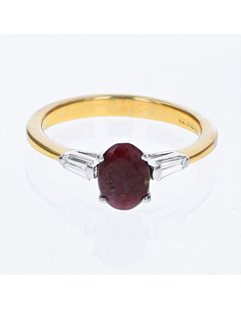The Olivia Collection 0.84 Carat Oval Ruby Center Stone With Emerald Cut Diamond Shoulders AGI Certificated Diamond Ring Set In 18 An Carat Yellow Gold Shank